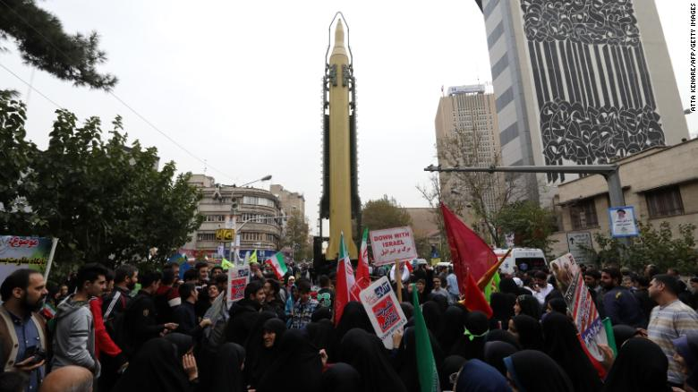 Iranians gather Saturday outside the ex-US Embassy in Tehran with a medium-range missile on display.