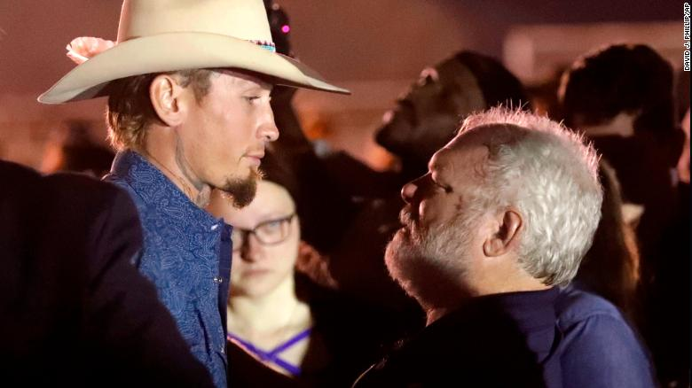 Stephen Willeford, right, meets Johnnie Langendorff at a vigil Monday for the shooting victims.