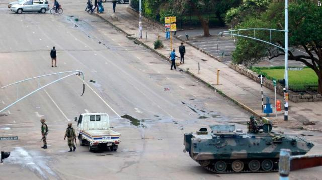 Soldiers and a military vehicle on the street in Harare.