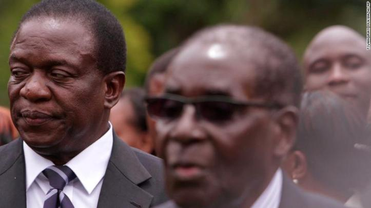 Emmerson Mnangagwa, left, served as a close aide to former leader Robert Mugabe, right.