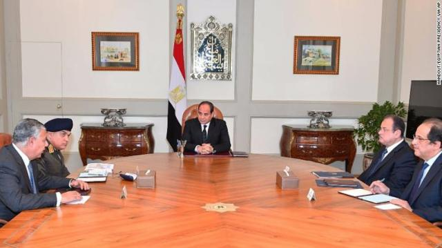President Abdel Fattah el-Sisi, center, meets with officials in Cairo after the mosque attack.