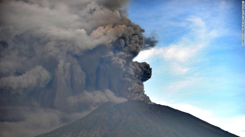 Mount Agung sent smoke rising thousands of meters into the air, shutting down flights.