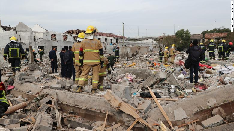 Rescue workers search the blast site.