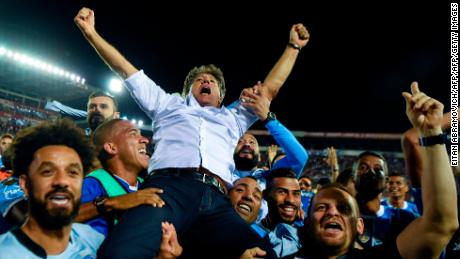 Renato Gaucho is held aloft by his players after guiding the to Libertadores glory.