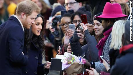 Prince Harry and fiancee Meghan Markle attend the Terrance Higgins Trust World AIDS Day charity fair in Nottingham on Friday.