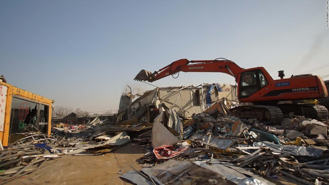 A market in south Beijing is torn down by a bulldozer days after the government issued demolition orders for thousands of structures.