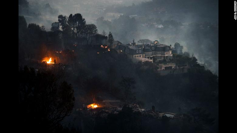"Fires surround a hilltop mansion in the wealthy Bel-Air district of Los Angeles on Wednesday, December 6. Powerful Santa Ana winds and extremely dry conditions are fueling <a href=""http://www.cnn.com/2017/12/07/us/ventura-fire-california/index.html"">wildfires in Southern California</a> in what has been a devastating year for <a href=""http://www.cnn.com/interactive/2017/12/us/california-wildfires-cnnphotos/"">such natural disasters in the state</a>."