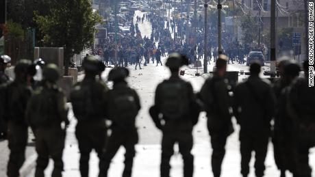 Israeli forces keep watch as Palestinians protest near a checkpoint in  Bethlehem on Thursday.