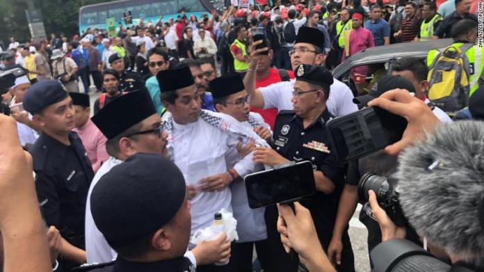 Protesters gather in Malaysia on Friday to denounce US President Donald Trump's decision on Jerusalem.