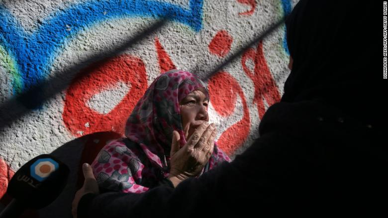 A relative of Mohammad Masry, who died in clashes with Israeli forces, mourns at his funeral Saturday.