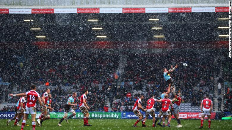 A rugby match went ahead at Twickenham Stoop in London despite the heavy snow.