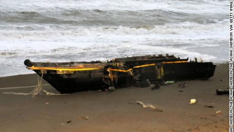 The wooden boat washed ashore at a beach on December 12, 2017 in Kashiwazaki, Niigata, Japan.
