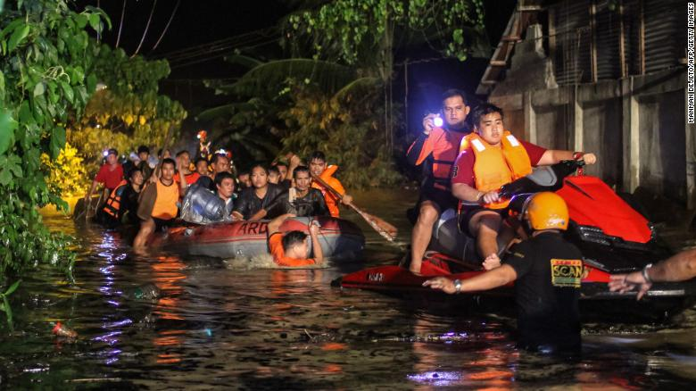"""Rescue workers evacuate residents in Davao on the southern Philippine island of Mindanao early Saturday, December 23, after <a href=""""http://www.cnn.com/2017/12/23/asia/philippines-tropical-storm-tembin/index.html"""" target=""""_blank"""">Tropical Storm Tembin</a> dumped heavy rains on the area. Tembin is the Philippines' second deadly tropical storm in a month."""