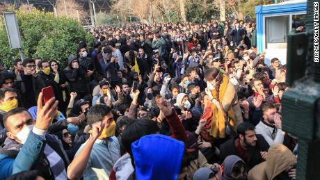 Iranian students protest at the University of Tehran during a demonstration driven by anger over economic problems on December 30.