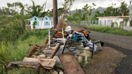 Rubble is piled along the roughly 70-mile path Maria took across the island.