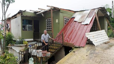 Three months after the storm, Manuel Morales still lives in an ad hoc shelter with his wife.