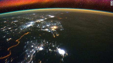 Bright swaths of red in the upper atmosphere, known as airglow, can be seen in this image taken from the International Space Station. NASA's ICON mission, with a planned launch for the summer of 2017, will observe how interactions between terrestrial weather and a layer of charged particles called the ionosphere create the colorful glow.