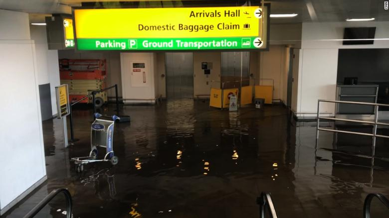 The flooding at Terminal 4 was caused by a water main break.