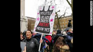 A protester carries a sign while marching in London on Sunday.