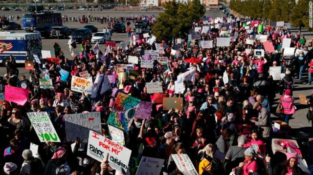 People attend the Women's March on Sunday in Las Vegas.