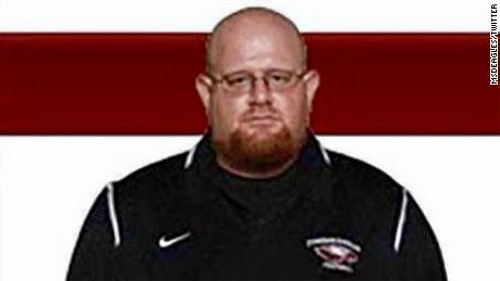 A football coach who shielded students from the Florida shooter died as he lived -- by putting himself second