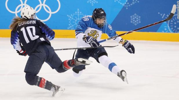 Finland's Ronja Savolainen, right, collides with American Meghan Duggan during a hockey semifinal.