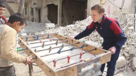 Najem and his friends find a spot of childhood happiness, playing foosball in their bombed out streets.
