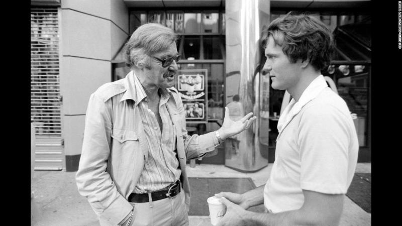 """Lee talks to actor Nicholas Hammond during the filming of the television series """"The Amazing Spider-Man"""" in 1978."""