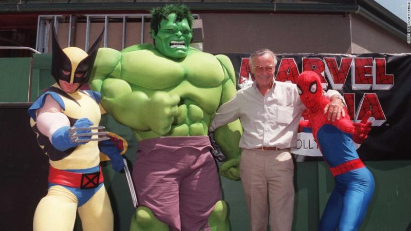 Lee poses with a few Marvel heroes in 1997.