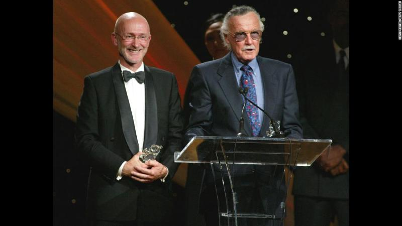 "Lee and film producer Ian Bryce accept a Faith and Values Award for the ""Spider-Man"" film in 2003."