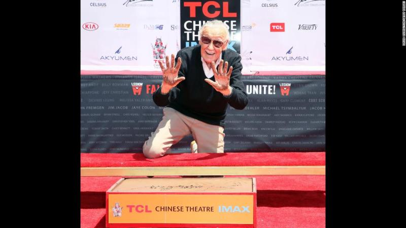Lee leaves his handprints and footprints outside the TCL Chinese Theatre in Hollywood in July 2017.