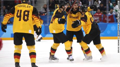 The German ice hockey team in action during the gold medal match.