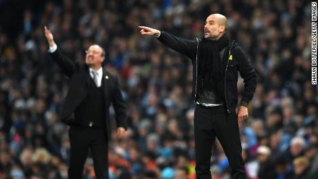 "Guardiola says he will continue to wear a yellow ribbon because he is ""a human being before being a manager."""