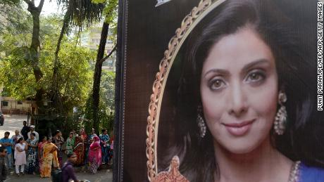 A picture of Bollywood actress Sridevi Kapoor is seen put up outside her residence in Mumbai on February 26, 2018, following her death.