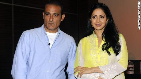"""Actor Akshaye Khanna (L) attends a promotional event with Sridevi for the film """"Mom in Mumbai"""" in June 2017."""