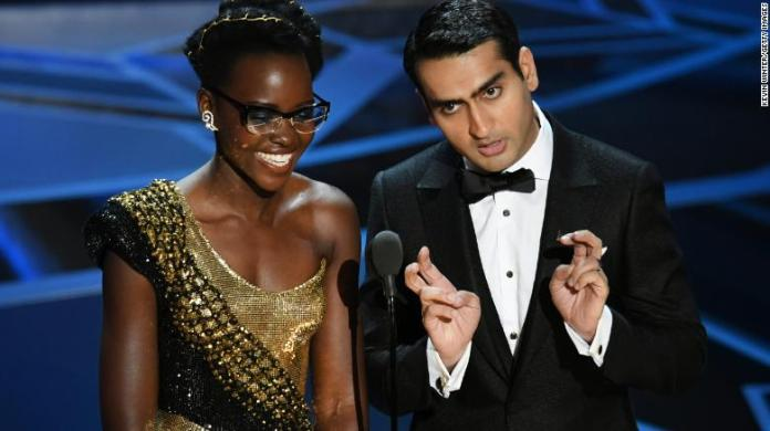 Actors Lupita Nyong'o and Kumail Nanjiani speak onstage during the 90th Annual Academy Awards at the Dolby Theatre on March 4, 2018