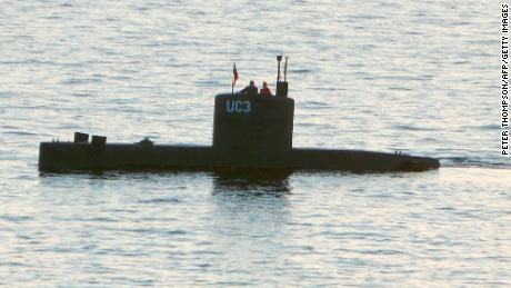 A woman alleged to be Kim Wall stands next to a man in the tower of the private submarine UC3 Nautilus on August 10, 2017, in Copenhagen harbor.
