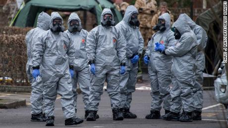 Military personnel wearing protective suits in Salisbury, England on March 11, 2018.