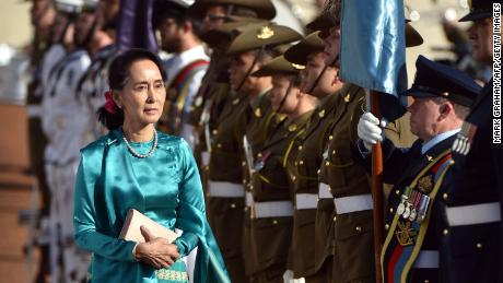 Suu Kyi receives an official welcome on the forecourt during her visit to Canberra on March 19.