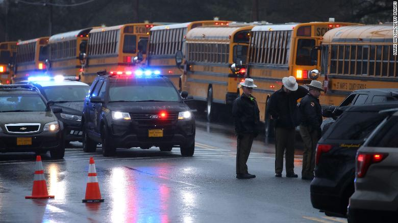 School buses lined up in front of Great Mills High School after a shooting on Tuesday to transport students to another school.
