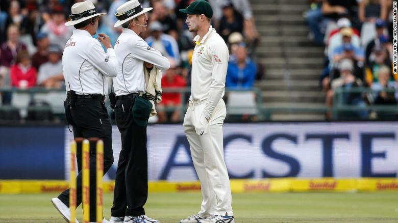 Australia's Cameron Bancroft (right) is questioned by umpires Richard Illingworth (left) and Nigel Llong.