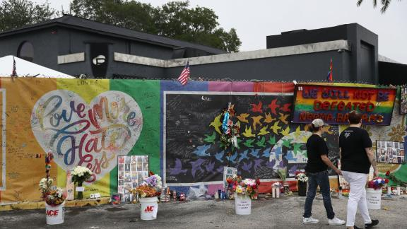 People visit a makeshift memorial in Orlando on June 12, 2017 -- one year to the day after the Pulse nightclub shooting.