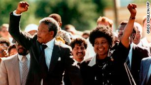 Nelson and Winnie Mandela raise clenched fists to supporters upon Nelson's release from jail in February 1990.