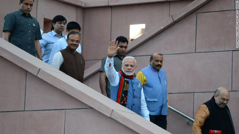 The government of Indian Prime Minister Narendra Modi, center, faced criticism over the measure.