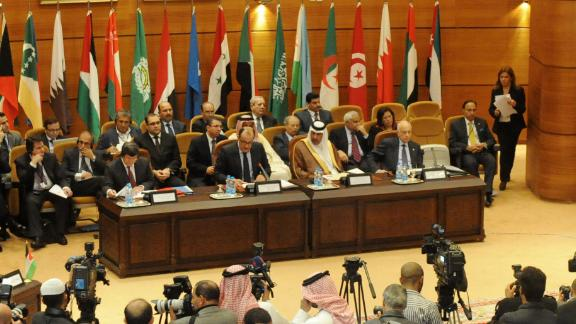 Delegates from Arab League member states and Turkey discuss a response to the government's crackdown in Syria on November 16, 2011.