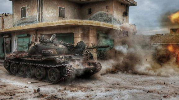Members of a Syrian opposition group attack the headquarters of al-Assad regime forces in the Aleppo villages of Nubul and al-Zahraa on February 12, 2016.