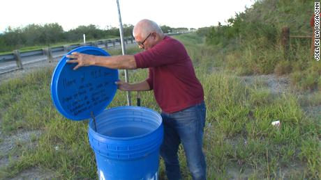 Eddie Canales, director of the South Texas Human Rights Center, checks a water station on a migrant route in Falfurrias, Texas.