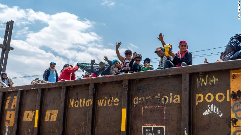 Migrants climbed onto the freight train Saturday in the city of Tultitlán, 1,500 miles south of the US-Mexico border.