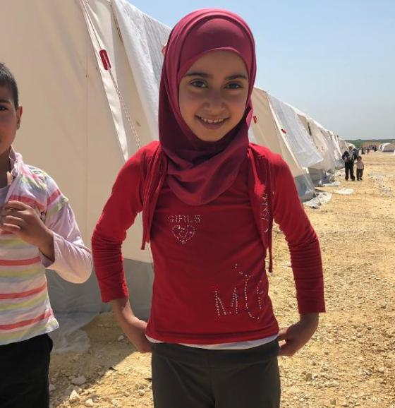 Ten-year-old girl Amira doesn't remember a time when her native neighborhood of Eastern Ghouta wasn't embroiled in war. Pictured at the al-Bol refugee camp in northern Syria with another evacuee, she says she wants to be a teacher when she grows up.