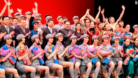 North Korean leader Kim Jong Un, center, claps while posing with Song Tao and members of a Chinese art troupe in Pyongyang.